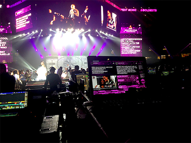 A view of the web browser running the Superdome event display and the display on the 100-foot screens on stage